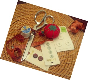 Scissors, Pin Cushion. Buttons, thread, tape measure